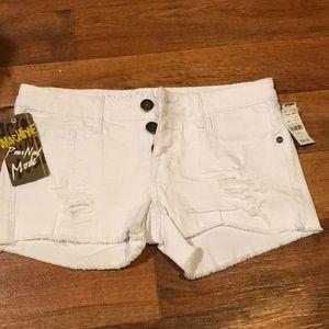 White, ripped juniors shorts by Machine